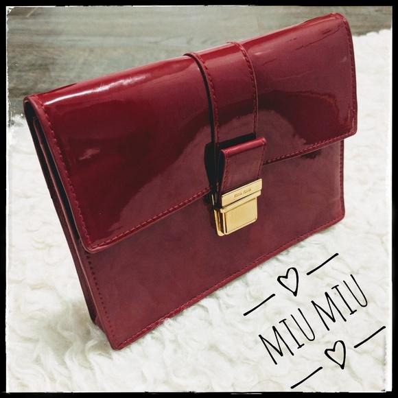 ... MIU Red Faux Patent Leather Clutch. M 5bafcbf01b329486fc903132 a3ae746496